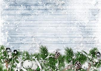 Christmas border with fir branches, jingle bells and snowfall. Greeting card