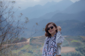 portrait head shot of asian woman and mountain scene in sapa vietnam