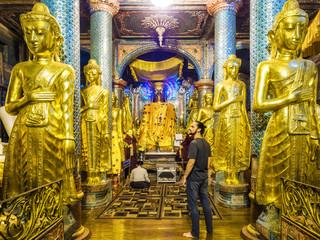Traveller visiting Shwedagon Pagoda temple in Yangon, Myanmar (Burma).