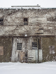 Abandoned Barn in Winter Storm