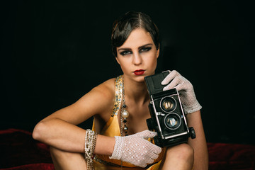Girl with vintage photo camera.