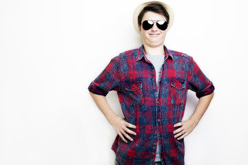 Handsome funny man with sunglasses and hat on a white background
