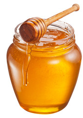 Jar full of fresh honey and honey dipper. File contains clipping path.