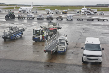 Airport runaway traffic on a rainy day. Travel background.