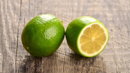 Juicy lime on a wooden background