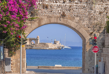 Exit from old town like bow with sea view and blue sea in Rhodes old town