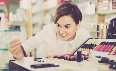 Female customer searching for reliable make-up products