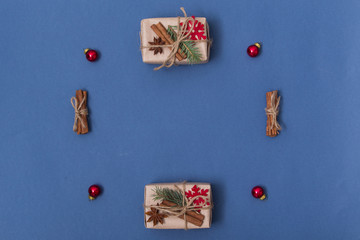 Concept christmas background with decorations, xmas tree and gift boxes on blue background. New year card. Empty space for your text. flatlay. Sigh symbol from number 2018