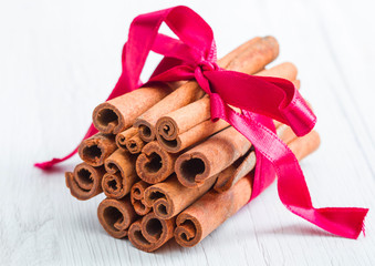 cinnamon stick with red ribbon