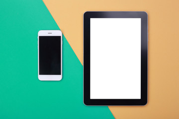 Top view Mockup tablet and smartphone on green and orange pastel background