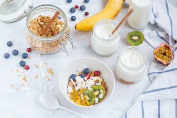 Healthy breakfast: muesli, yoghurt, fruit