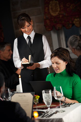 Restaurant: Woman Ordering Dinner From Menu