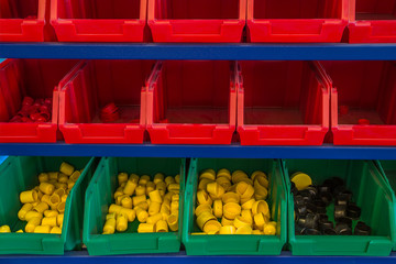 Colourful plastic sorting bins with nuts and bolts