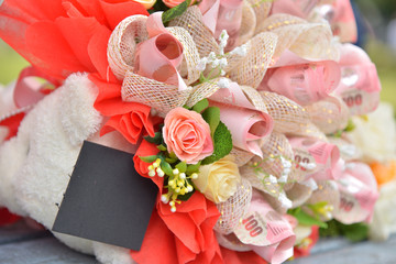 Fake flowers bouquet on wallpaper background