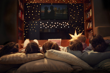 Family Enjoying Movie Night At Home Together Wall mural