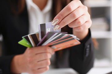 Female arm hold bunch of credit cards