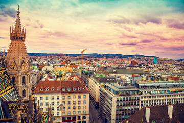 Wall Mural - Aerial view  of Vienna from the north tower of St. Stephen's Cathedral with evening colorful sky, Austria, Europe