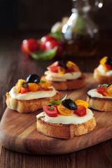 Bruschetta with tomatoes and mozzarella.
