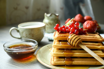 Belgian waffles with honey and fresh berries