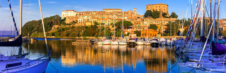 travel in Italy - picturesque tranquil Capodimonte village in lake Bolsena over sunset.