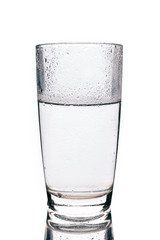 Glass with cold water isolated on white background