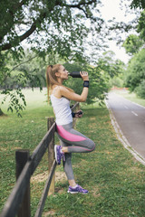 Woman drinking water in the park