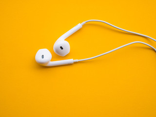 earphones on yellow background