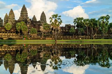 Children running in front of Angkor Wat