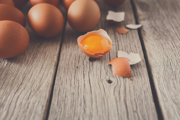 Fresh chicken brown eggs on rustic wood, organic farming concept