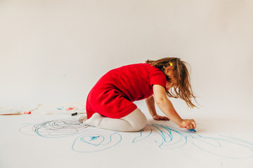 a little girl learns to draw