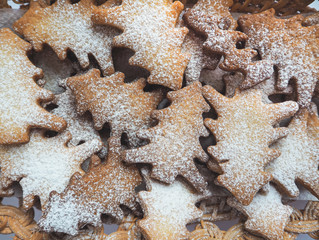 Festive Christmas cookies. Background of shortbread in the shape of Christmas trees.