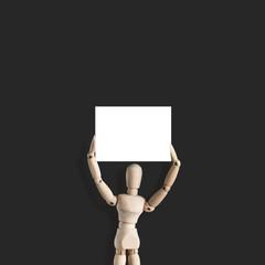 Empty white board above head of wooden mannequin on dark background