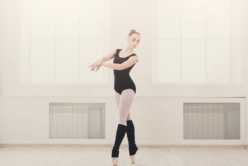 Beautiful ballerina stands in ballet pirouette