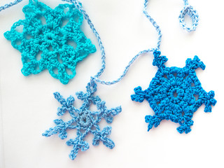 Three Blue Crocheted Snowflakes on a Garland Chain