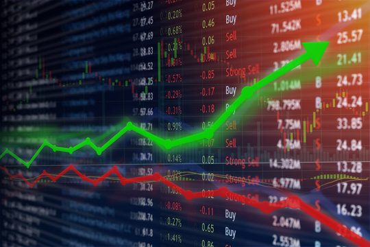 Investing and stock market concept gain and profits with faded candlestick charts.