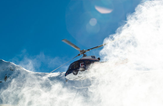 Heliboarding on top of a moutain