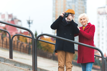 senior couple taking photo