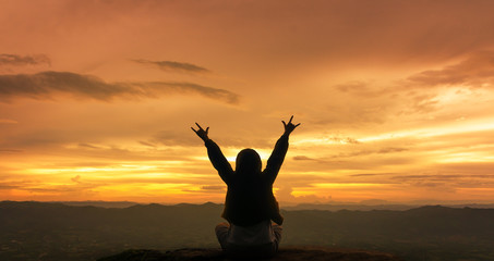 Silhouette freedom woman rise hands up to welcome a good day , open arms motivate enjoy and success about love