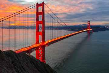 The sun rises over San Francisco and the Golden Gate Bridge Wall mural