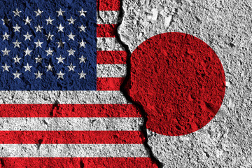 Crack between America and Japan flags. political relationship concept