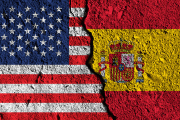 Crack between America and Spain flags. political relationship concept