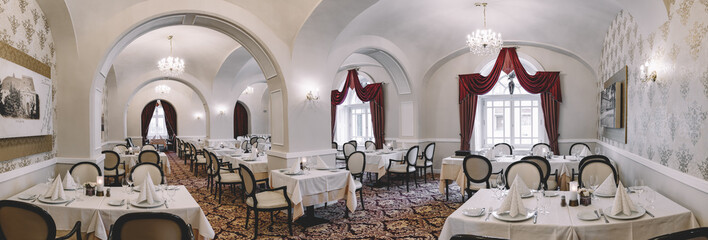 Beautiful wedding venue. Elegant restaurant. Panoramic wide angle image of restaurant interior.