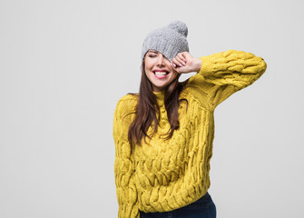Beautiful woman winter portrait. Smiling girl wearing warm clothes having fun