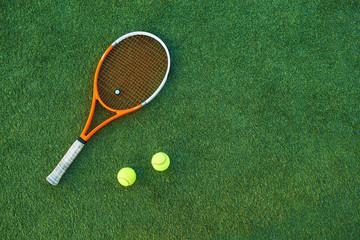 Tennis ball and rackets on grass