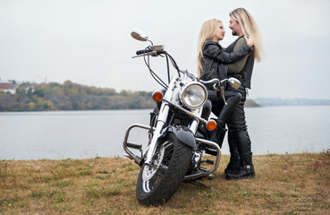 Couple on a bike in a leather jackets