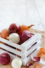 Raw onions in box