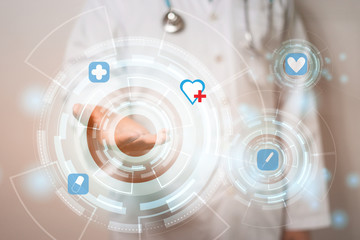 hand male medical doctor show holding heart in palm ,Healthcare concept.modern medical type of buttons show technology