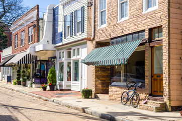 Traditional American Stores along a Cobblestone Street