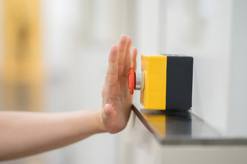 Finger of women pressing emergency sos button to contact with call center to ask for help after car accident ,hand trying to press in front of the elevator,safety first and security background concept