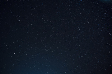 Night scape with beautiful stary sky at the high mountain. Star texture. Space background.